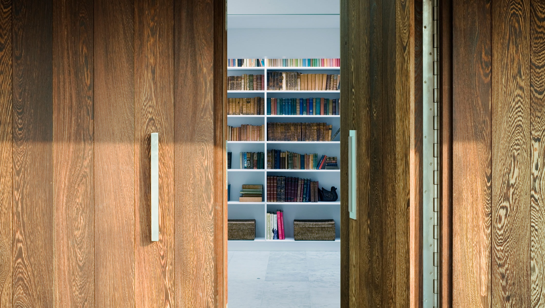 Willow House entrance door and library view
