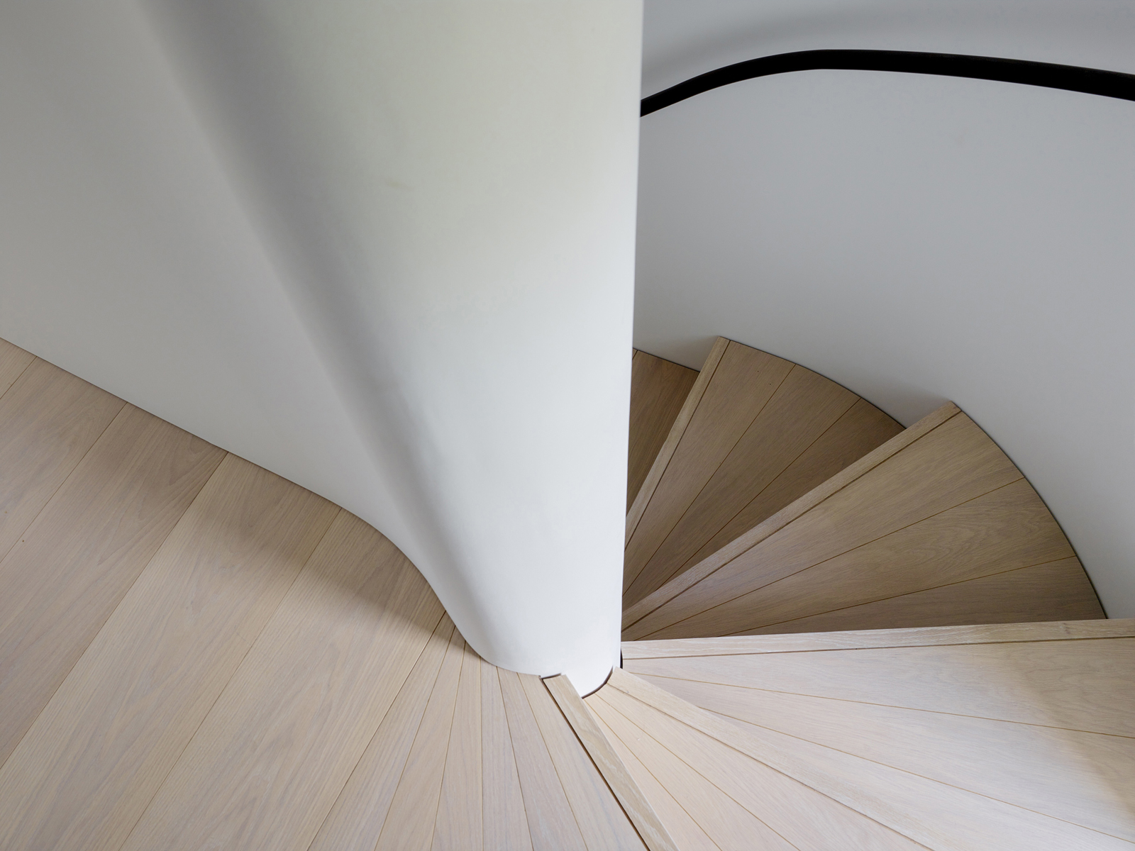 Curved timber stair shadow gap detail
